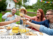 Купить «happy friends with drinks at summer garden party», фото № 26336324, снято 28 августа 2016 г. (c) Syda Productions / Фотобанк Лори
