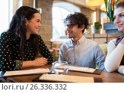 Купить «happy friends with menu at restaurant», фото № 26336332, снято 19 ноября 2016 г. (c) Syda Productions / Фотобанк Лори