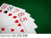 Купить «poker hand of playing cards on green casino cloth», фото № 26336448, снято 15 марта 2017 г. (c) Syda Productions / Фотобанк Лори