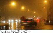Купить «Street lights of city in fog and cars on way», видеоролик № 26340624, снято 5 апреля 2017 г. (c) Денис Дряшкин / Фотобанк Лори