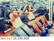 man and woman doing abs exercise in gym. Стоковое фото, фотограф Яков Филимонов / Фотобанк Лори