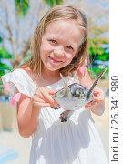 Купить «A little cute girl with a small turtle in her hands in the reserve», фото № 26341980, снято 10 апреля 2017 г. (c) Дмитрий Травников / Фотобанк Лори