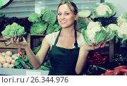Купить «professional young female seller holding fresh cabbage on market», фото № 26344976, снято 18 июня 2019 г. (c) Яков Филимонов / Фотобанк Лори