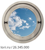 Купить «Круглое окно с видом на голубое небо и легкие облака», фото № 26345000, снято 28 марта 2017 г. (c) Светлана Васильева / Фотобанк Лори