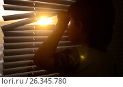 Boy opens the shutters and looks at the sun. Стоковое фото, фотограф Юлия Дакалова / Фотобанк Лори