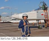 Купить «Military pilot in helmet stands near jet plane», фото № 26346016, снято 22 сентября 2010 г. (c) Фотограф / Фотобанк Лори