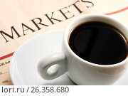 Купить «Чашка чёрного кофе с блюдцем на газете с финансовыми новостями», фото № 26358680, снято 14 февраля 2010 г. (c) Александр Гаценко / Фотобанк Лори