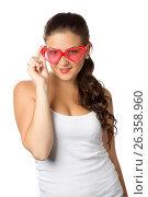 Young girl is holding red sunglasses, фото № 26358960, снято 6 июля 2011 г. (c) Tatjana Romanova / Фотобанк Лори
