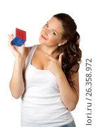 Young woman and sucsessful cube on white, фото № 26358972, снято 6 июля 2011 г. (c) Tatjana Romanova / Фотобанк Лори
