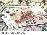Купить «Российский рубль на американских долларах», фото № 26359040, снято 23 апреля 2014 г. (c) Александр Гаценко / Фотобанк Лори