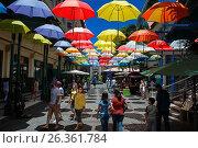 Купить «Caudan waterfront area with colorful umbrella covering, Port Louis, Mauritius island.», фото № 26361784, снято 27 ноября 2015 г. (c) age Fotostock / Фотобанк Лори