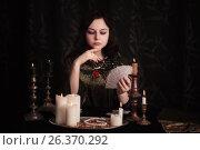 Купить «Young woman with divination cards in room», фото № 26370292, снято 5 марта 2017 г. (c) Майя Крученкова / Фотобанк Лори