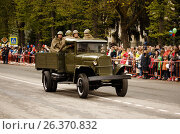 RUSSIAN, KOZELSK, MAY 9, 2017, Victory Day, May 9. Military Parade on anniversary of Victory in Great Patriotic War. Old truck GAZ-AA. Retro military vehicle With Re-Enactors Dressed As Red Army Soldiers. Редакционное фото, фотограф Олег Безруков / Фотобанк Лори