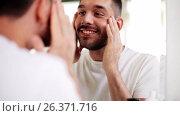 Купить «happy young man looking to mirror at home bathroom», видеоролик № 26371716, снято 13 мая 2017 г. (c) Syda Productions / Фотобанк Лори