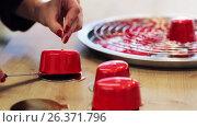 Купить «chef serving mirror glaze cakes at pastry shop», видеоролик № 26371796, снято 23 июля 2019 г. (c) Syda Productions / Фотобанк Лори