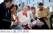 Купить «international business team with papers outdoors», видеоролик № 26371816, снято 22 января 2020 г. (c) Syda Productions / Фотобанк Лори