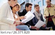 Купить «international business team with papers outdoors», видеоролик № 26371820, снято 16 июля 2020 г. (c) Syda Productions / Фотобанк Лори