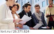 Купить «international business team with papers outdoors», видеоролик № 26371824, снято 22 января 2020 г. (c) Syda Productions / Фотобанк Лори