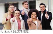 Купить «international business team showing thumbs up», видеоролик № 26371832, снято 27 февраля 2020 г. (c) Syda Productions / Фотобанк Лори
