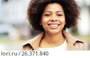 Купить «close up happy african american woman outdoors», видеоролик № 26371840, снято 8 апреля 2020 г. (c) Syda Productions / Фотобанк Лори