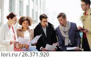 Купить «international business team with papers outdoors», видеоролик № 26371920, снято 20 мая 2017 г. (c) Syda Productions / Фотобанк Лори
