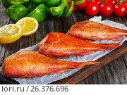 Купить «Red Sea Bass on parchment paper, close-up», фото № 26376696, снято 22 февраля 2019 г. (c) Oksana Zh / Фотобанк Лори