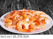 Купить «Tails of shrimps on a white plate, close-up», фото № 26376924, снято 22 февраля 2020 г. (c) Oksana Zh / Фотобанк Лори