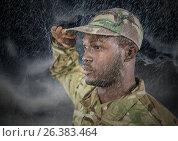 Купить «foreground of soldier saluting in the storm.», фото № 26383464, снято 23 июня 2018 г. (c) Wavebreak Media / Фотобанк Лори