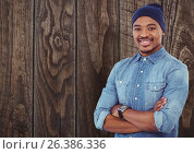 Купить «Casual man with wooly hat standing on ahead a wood wall», фото № 26386336, снято 24 февраля 2019 г. (c) Wavebreak Media / Фотобанк Лори