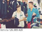 Купить «Cheerful male and his son shopping sport clothing», фото № 26389428, снято 27 сентября 2016 г. (c) Яков Филимонов / Фотобанк Лори