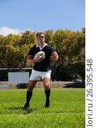Купить «Rugby player playing on field against trees», фото № 26395548, снято 9 февраля 2017 г. (c) Wavebreak Media / Фотобанк Лори