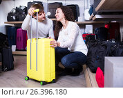 Купить «Couple choosing travel suitcase in shop», фото № 26396180, снято 23 сентября 2018 г. (c) Яков Филимонов / Фотобанк Лори