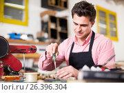 Купить «Carpenter working in studio», фото № 26396304, снято 8 апреля 2017 г. (c) Яков Филимонов / Фотобанк Лори