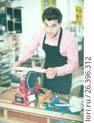 Купить «Craftsman working on woodworking machine», фото № 26396312, снято 8 апреля 2017 г. (c) Яков Филимонов / Фотобанк Лори