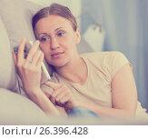 Купить «Upset woman with phone», фото № 26396428, снято 12 апреля 2017 г. (c) Яков Филимонов / Фотобанк Лори