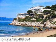 Купить «View of the empty beach with the bulldozer and the excavator», фото № 26409084, снято 22 февраля 2019 г. (c) Nobilior / Фотобанк Лори