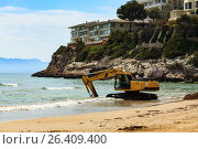 Купить «View of the empty beach with the excavator. Salou, Spain», фото № 26409400, снято 22 февраля 2019 г. (c) Nobilior / Фотобанк Лори