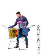 Купить «Husband man doing laundry isolated on white», фото № 26410240, снято 6 марта 2017 г. (c) Elnur / Фотобанк Лори