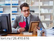 Купить «Businessman feeling love and loved in the office», фото № 26410616, снято 3 февраля 2017 г. (c) Elnur / Фотобанк Лори
