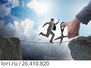 Купить «Hand cutting the rope under businessman tightrope walker», фото № 26410820, снято 5 июля 2020 г. (c) Elnur / Фотобанк Лори