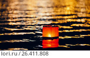Купить «Floating lighting water Lanterns on river at night», фото № 26411808, снято 15 октября 2018 г. (c) Константин Шишкин / Фотобанк Лори