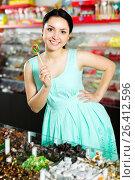 Купить «Woman posing to photographer with lollypop», фото № 26412596, снято 25 апреля 2017 г. (c) Яков Филимонов / Фотобанк Лори