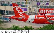 Купить «AirAsia Airbus 320 taxiing», видеоролик № 26419484, снято 21 ноября 2015 г. (c) Игорь Жоров / Фотобанк Лори