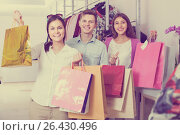 Купить «adults in good mood holding bags at clothing store», фото № 26430496, снято 24 января 2020 г. (c) Яков Филимонов / Фотобанк Лори