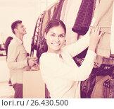 Купить «adults in good mood shopping at the clothing store», фото № 26430500, снято 22 ноября 2018 г. (c) Яков Филимонов / Фотобанк Лори