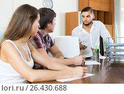 Купить «Couple with agent at office», фото № 26430688, снято 12 ноября 2019 г. (c) Яков Филимонов / Фотобанк Лори