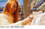 Купить «Portrait a woman in glasses at clothing store chose a dress - shopping concept», видеоролик № 26446320, снято 18 января 2020 г. (c) Константин Шишкин / Фотобанк Лори