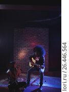 Купить «Female singer with guitarist practicing in nightclub», фото № 26446564, снято 7 марта 2017 г. (c) Wavebreak Media / Фотобанк Лори