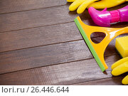 Купить «Cleaning equipment arranged on wooden floor», фото № 26446644, снято 21 октября 2016 г. (c) Wavebreak Media / Фотобанк Лори