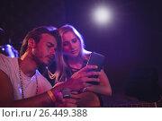 Купить «Musicians using mobile phone while practicing in nightclub», фото № 26449388, снято 7 марта 2017 г. (c) Wavebreak Media / Фотобанк Лори